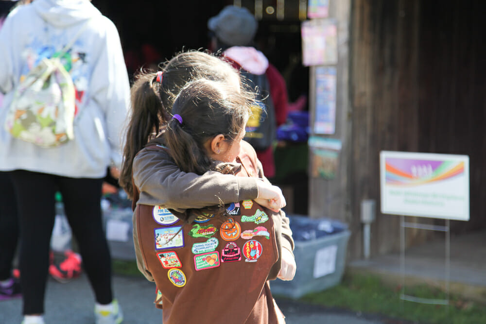 Girl Scout wearing a myriad of custom patches.